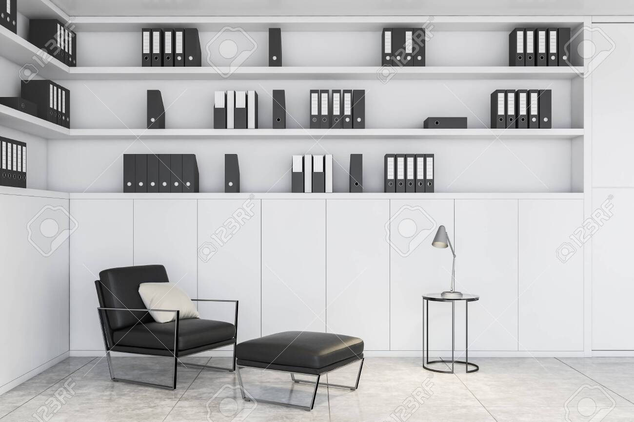 Office lounge area or home office with white bookcase, comfortable..