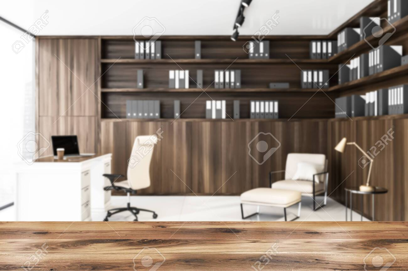 Blurred interior of luxury CEO office with wooden bookcase with..