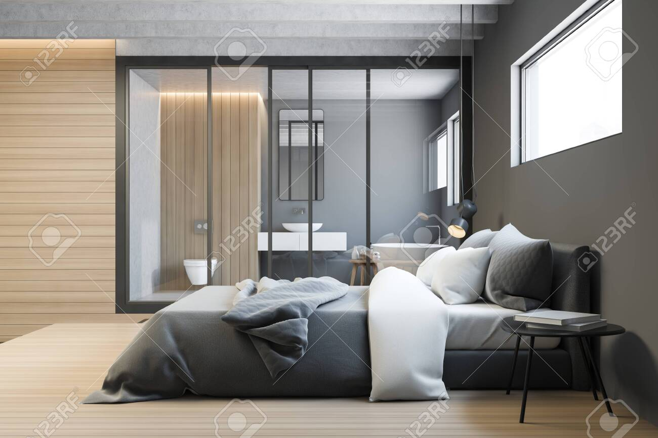 Side view of master bedroom with gray walls, wooden floor, king..