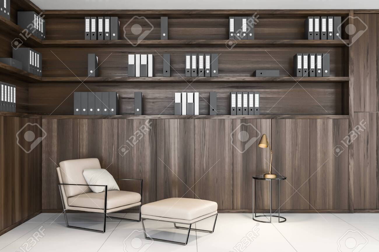 Office lounge area or home office with dark wooden bookcase,..