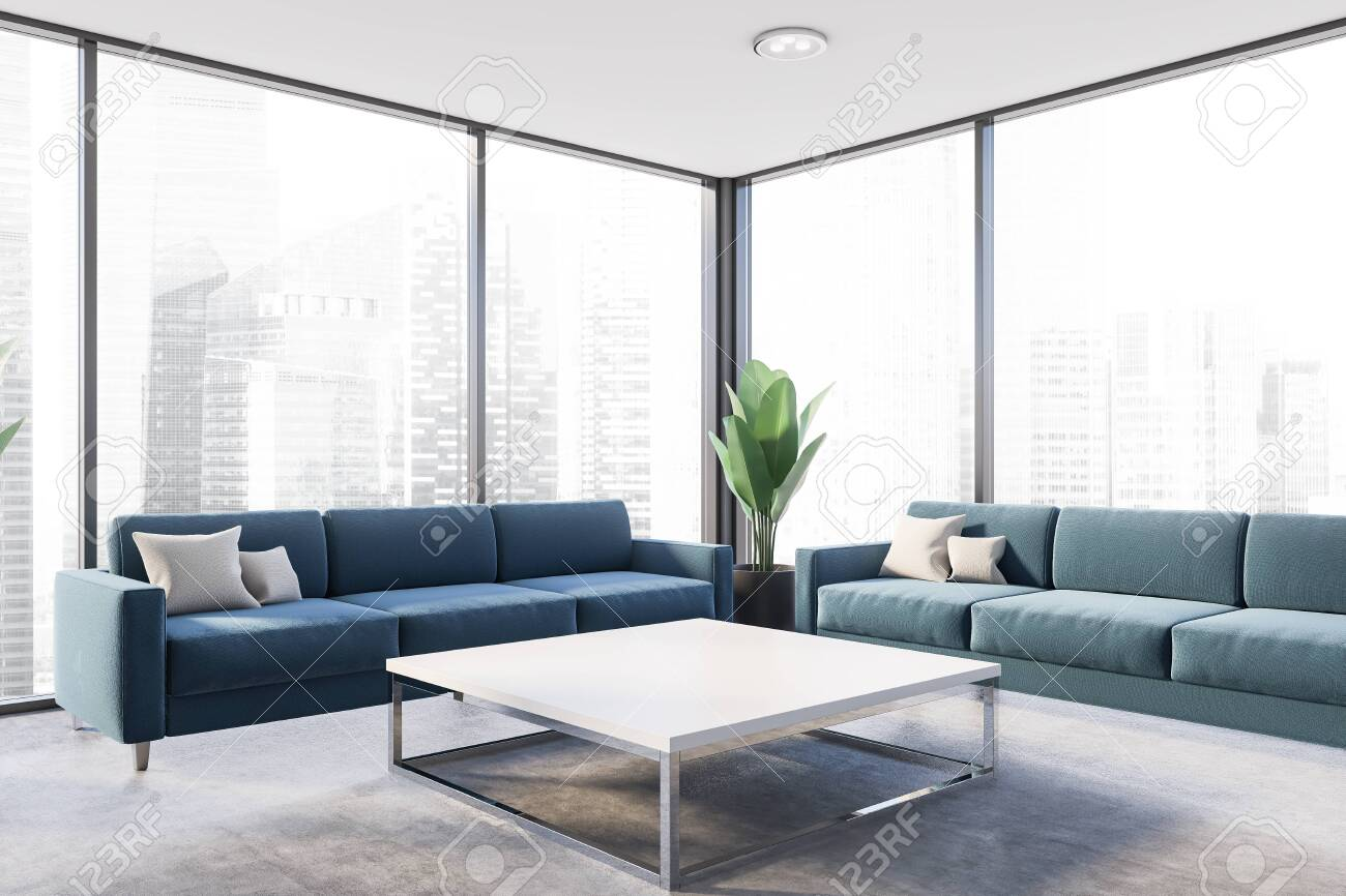 Interior of panoramic living room with concrete floor, two blue..