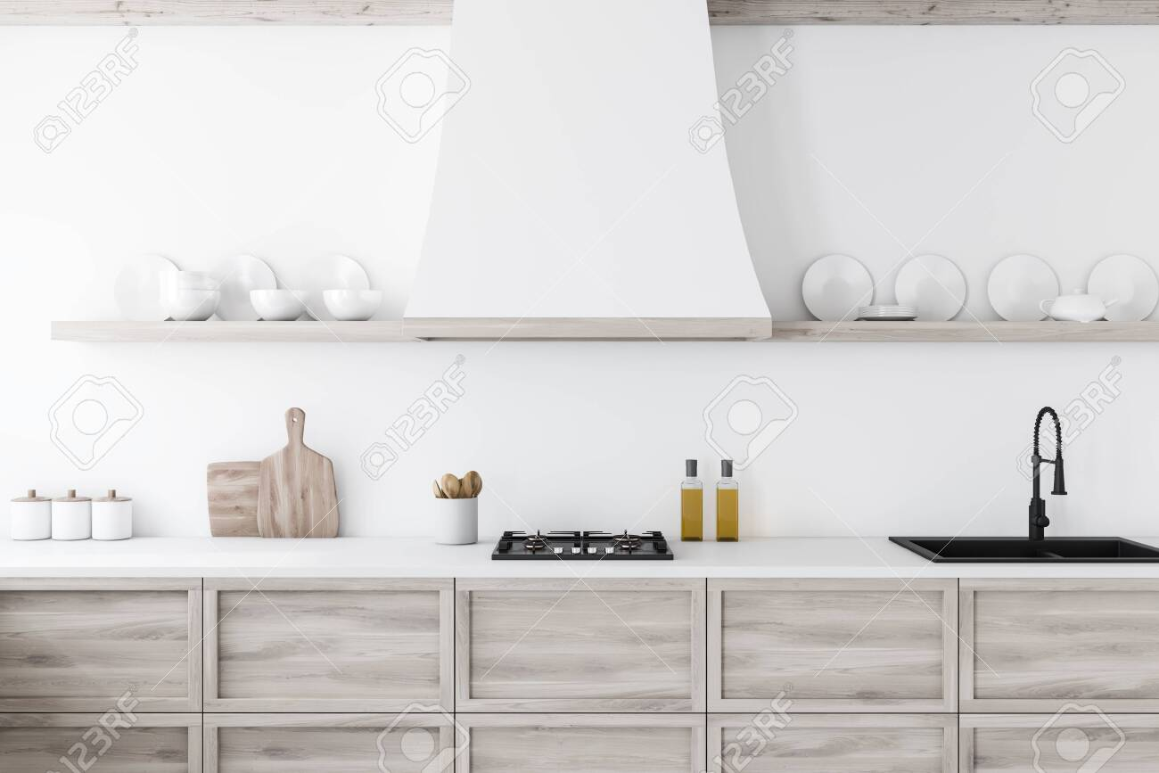 Close up of wooden kitchen countertop with built in sink and..