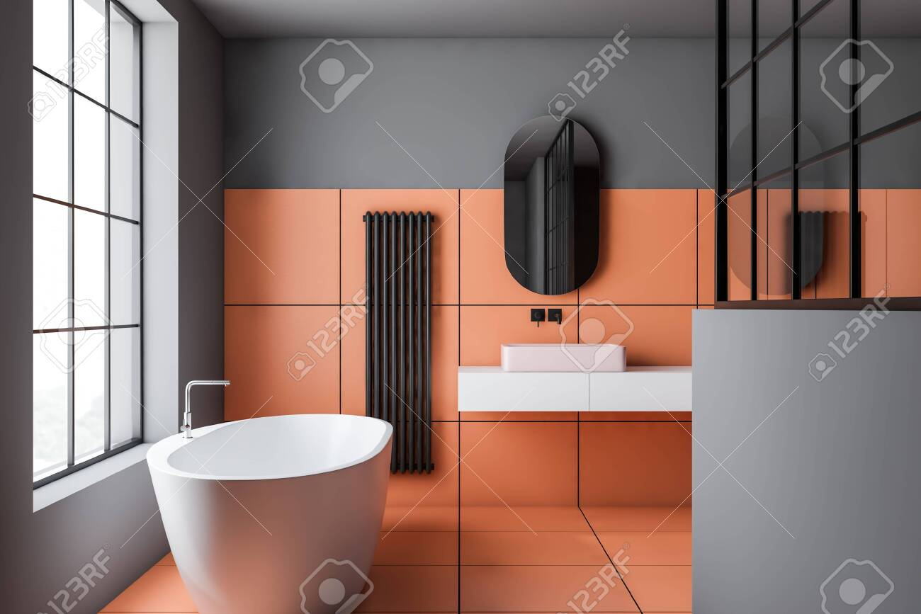 Interior Of Modern Bathroom With Gray And Orange Tile Walls