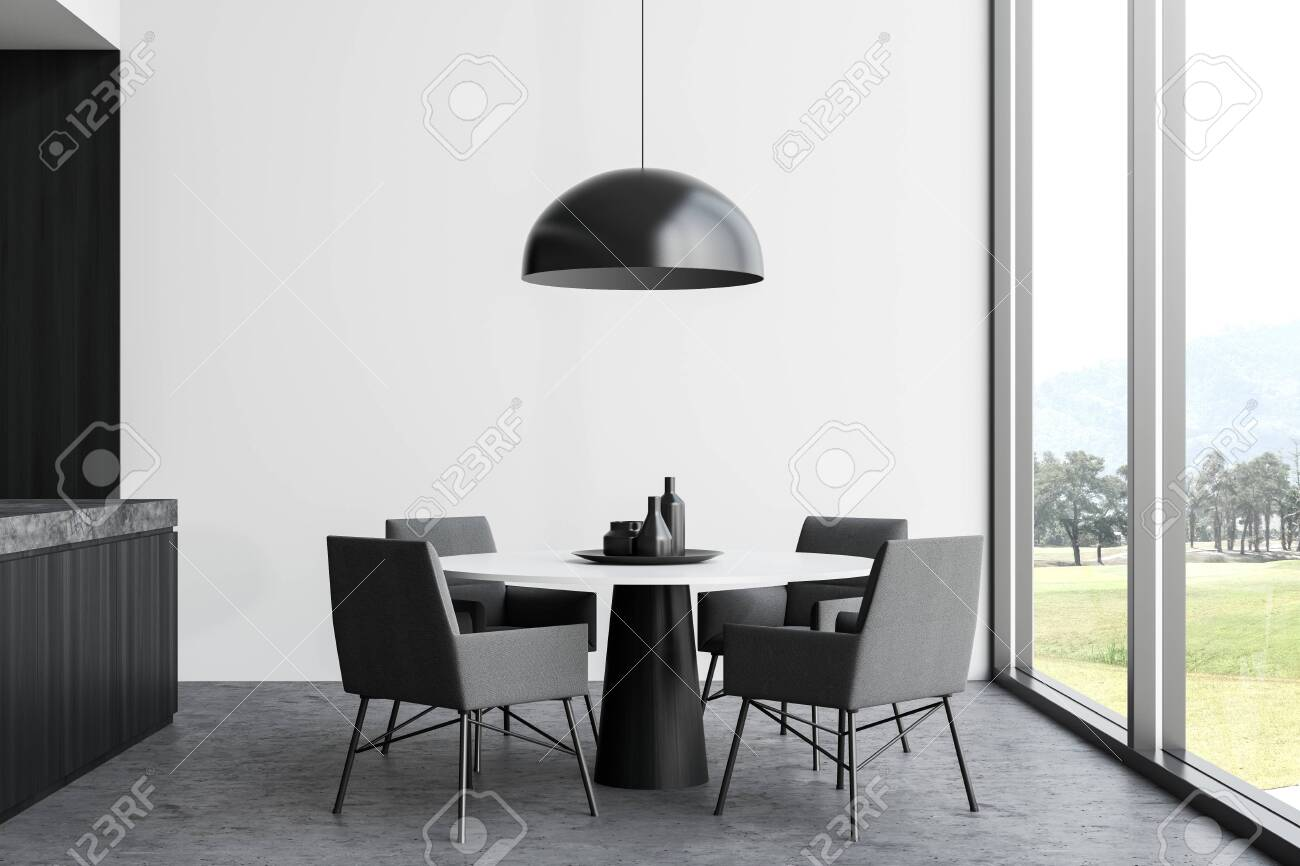 Interior Of Stylish Dining Room With White Walls Concrete Floor Stock Photo Picture And Royalty Free Image Image 129407245