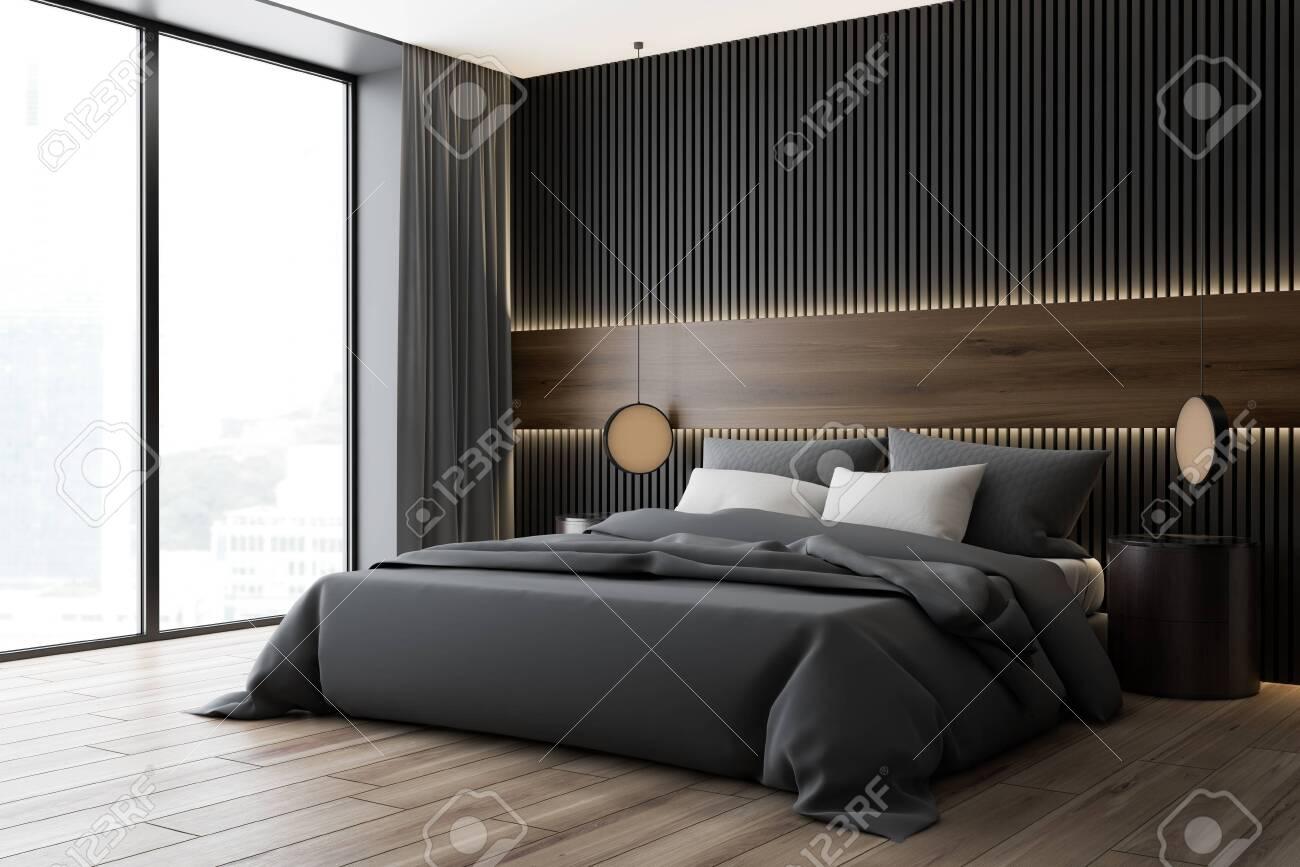 Corner of modern bedroom with dark wood and gray walls, wooden..
