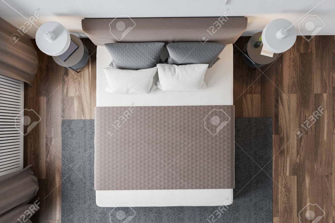 Top view of master bedroom with white walls, wooden floor, window..