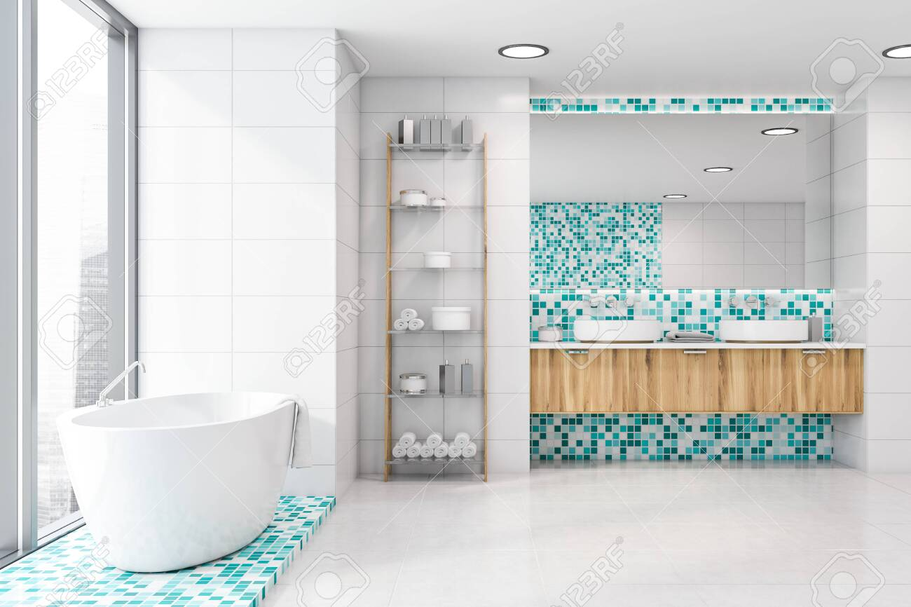 Interior Of Modern Bathroom With White Tile And Blue Mosaic Walls