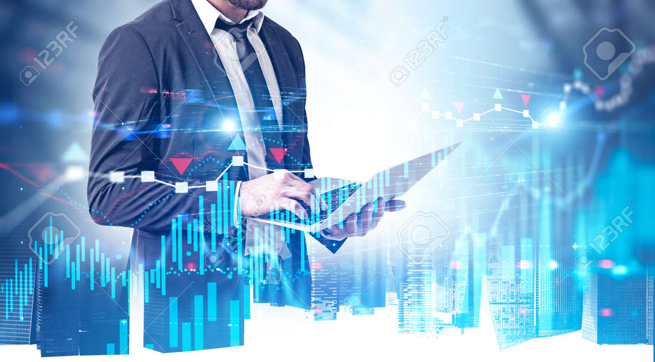 Bearded young businessman using laptop in modern city with double exposure of digital graph and network interface. Concept of stock market and smart city. Toned image - 130181797