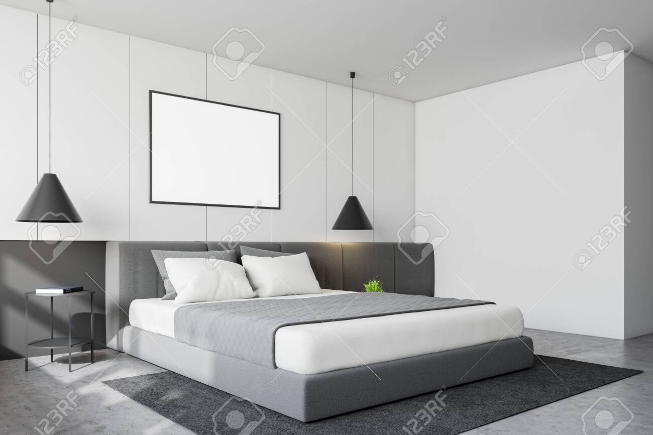 Corner Of Modern Bedroom With White Walls Concrete Floor King Stock Photo Picture And Royalty Free Image Image 130598825