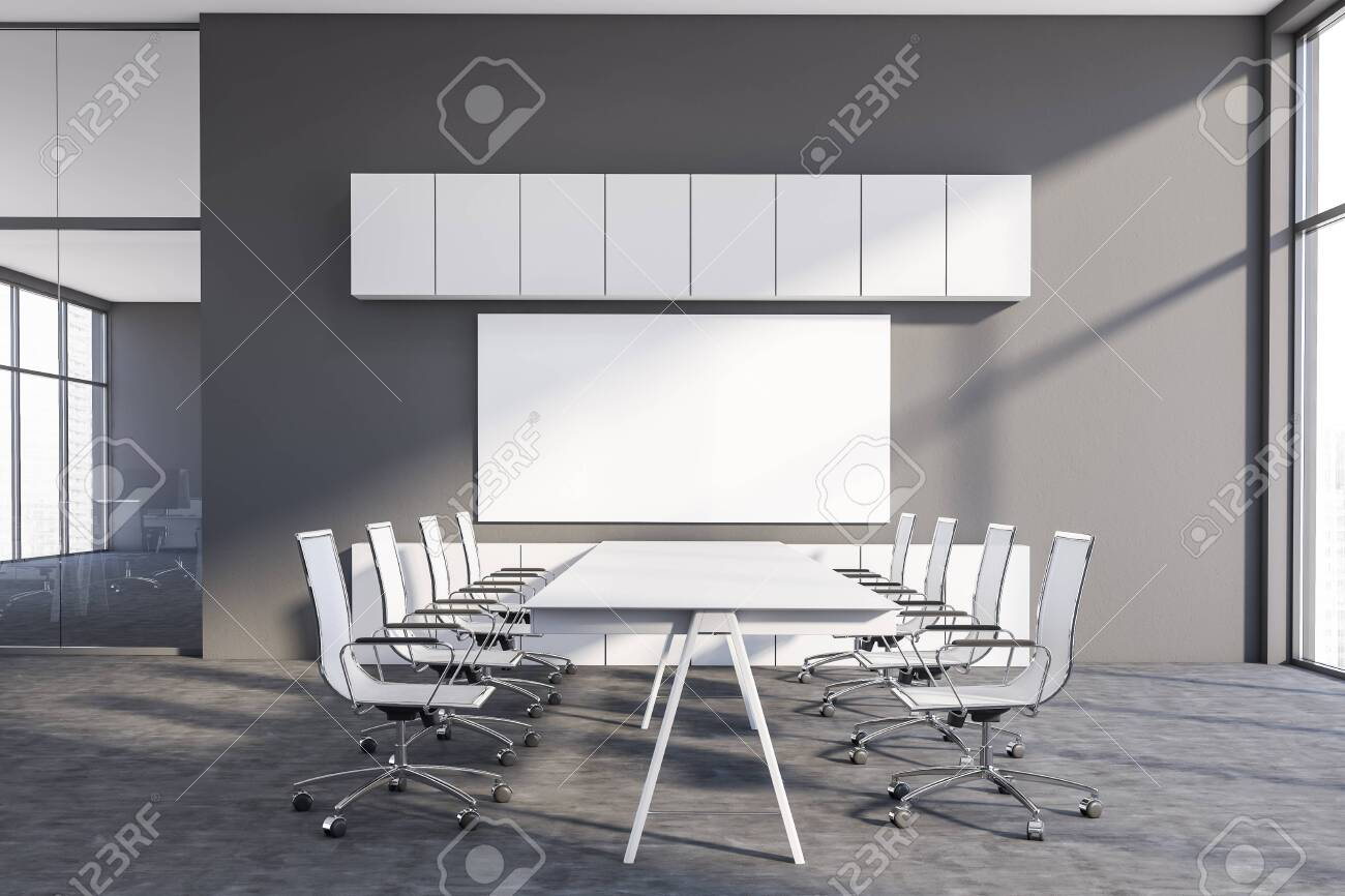 Interior of modern conference room with gray walls, long white..
