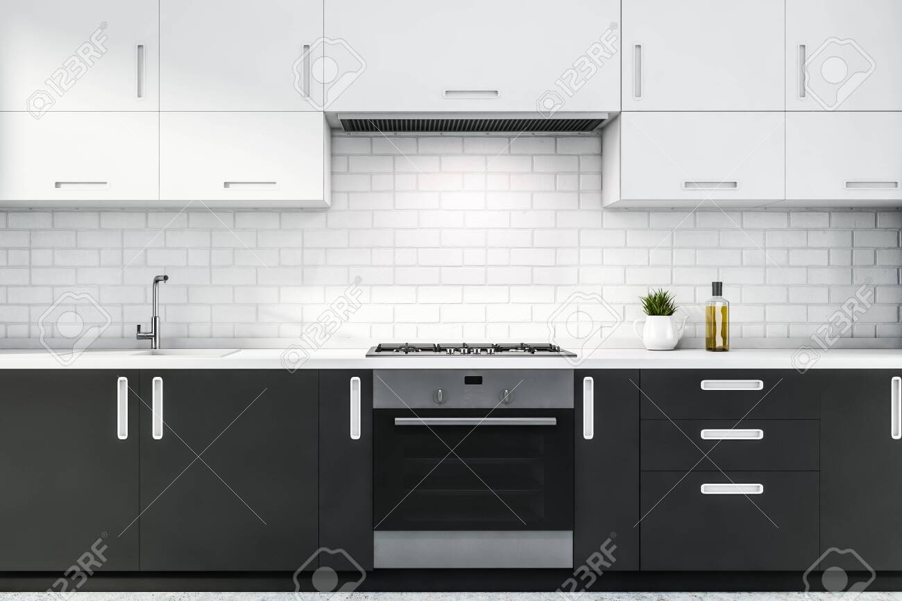 Close Up Of Gray Kitchen Countertops With Built In Stove And Stock Photo Picture And Royalty Free Image Image 131328539