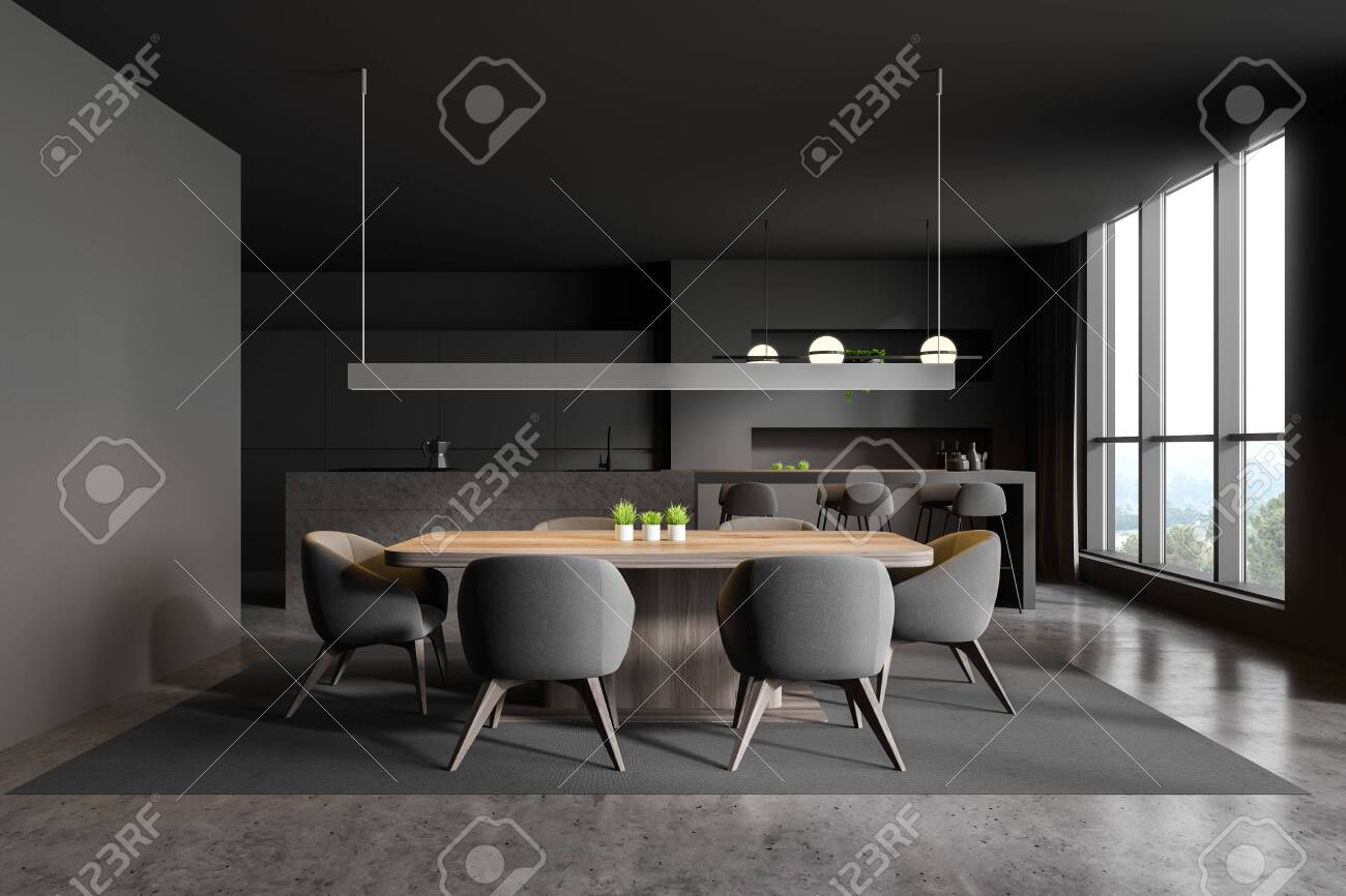 Interior Of Modern Kitchen And Dining Room With Dark Grey Walls Stock Photo Picture And Royalty Free Image Image 134483782