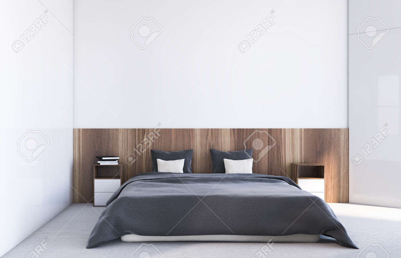 Interior of comfortable bedroom with white and wooden walls, carpet on the floor and comfortable king size bed with wooden bedside tables. 3d rendering - 139294486