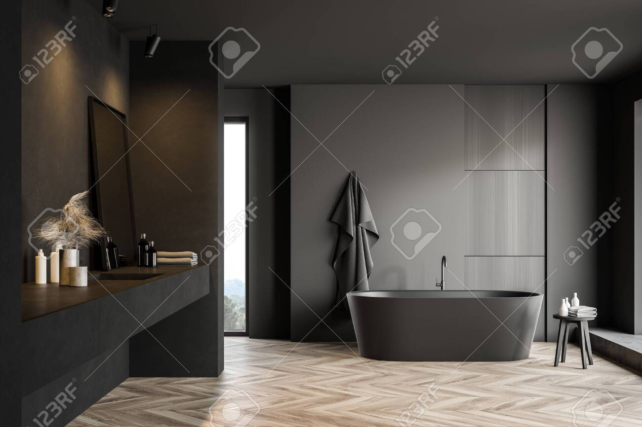 Modern Bathroom Interior With Dark Grey Walls Wooden Floor Stock Photo Picture And Royalty Free Image Image 139679112