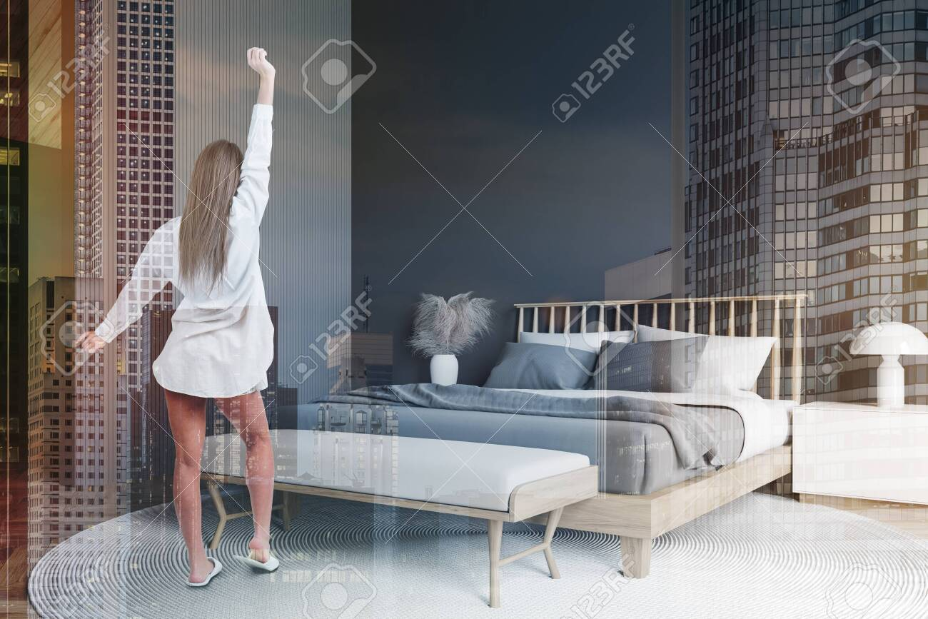 Young Woman In Nightgown Standing In Modern Bedroom With Gray Stock Photo Picture And Royalty Free Image Image 140314491