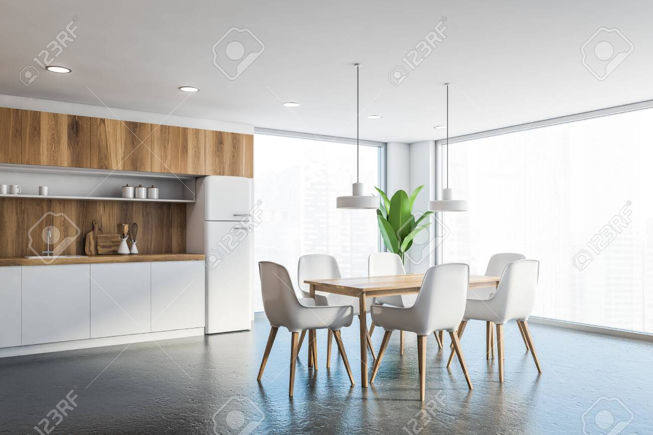 Corner Of Panoramic Kitchen With White Walls Concrete Floor Stock Photo Picture And Royalty Free Image Image 140251832