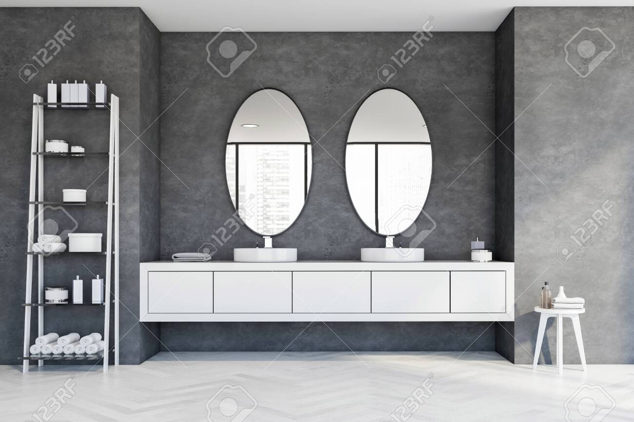 White Round Double Sink Standing On Countertops With Oval Mirrors Stock Photo Picture And Royalty Free Image Image 141446315