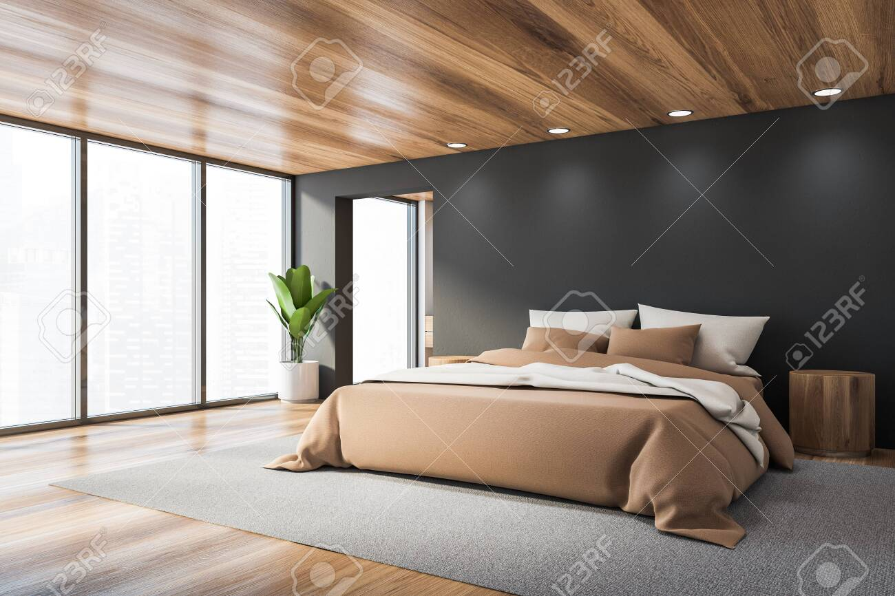 Corner Of Stylish Panoramic Bedroom With Grey Walls Wooden Floor Stock Photo Picture And Royalty Free Image Image 141206318