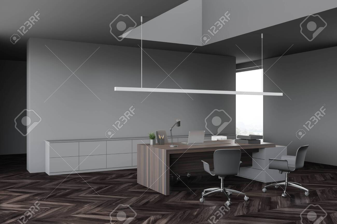 Corner Of Modern Ceo Office With Gray Walls Dark Wooden Floor Stock Photo Picture And Royalty Free Image Image 147605360