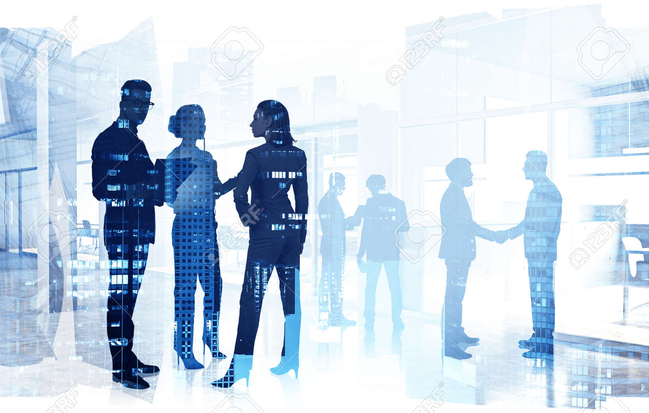 Silhouettes of business people working in blurry office with double exposure of cityscape. Toned image - 153466042