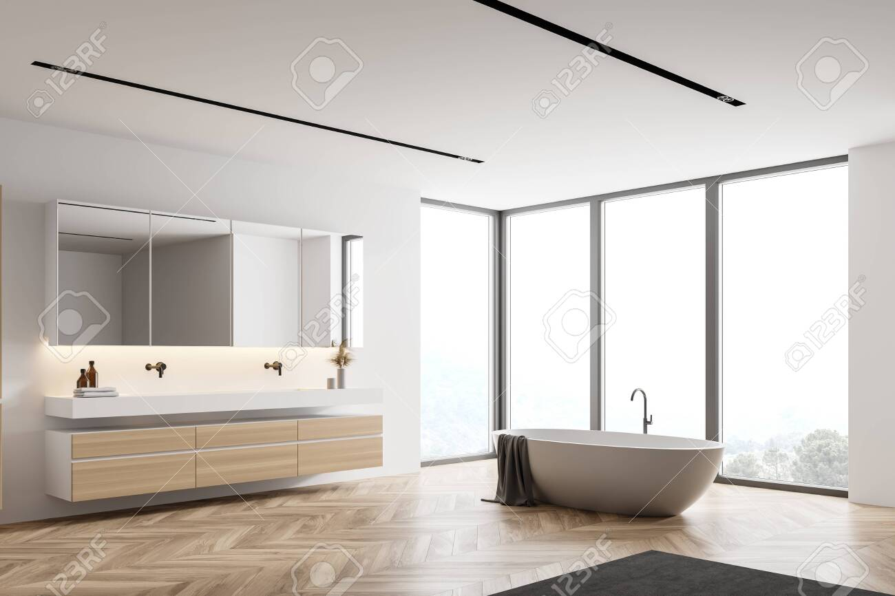 Corner Of Modern Bathroom With White Walls Wooden Floor Double Stock Photo Picture And Royalty Free Image Image 153586740