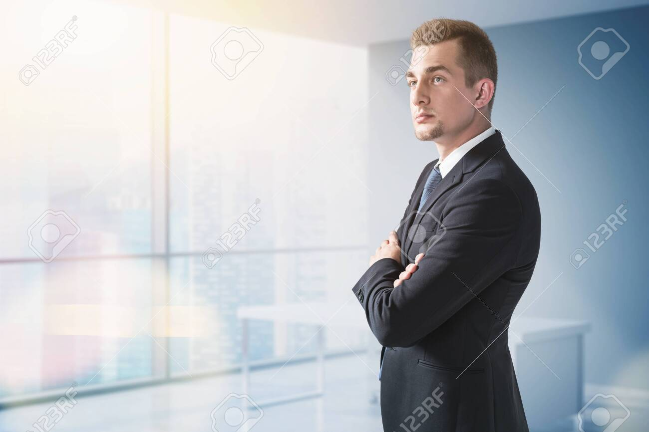 Confident businessman in suit in panoramic office - 157826130