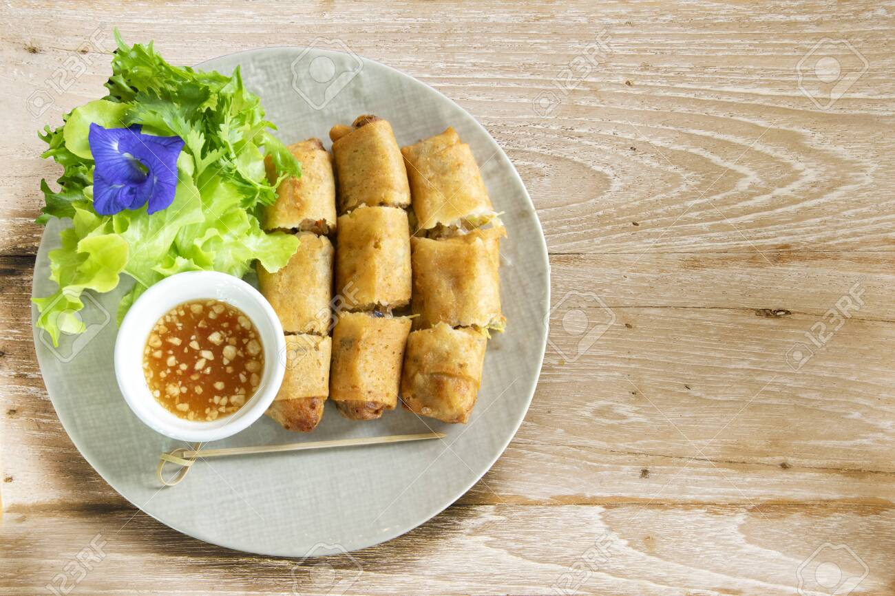 A Plate Of Deep Fried Spring Rolls With Sweet Chili Dip Sauce Stock Photo Picture And Royalty Free Image Image 128219761