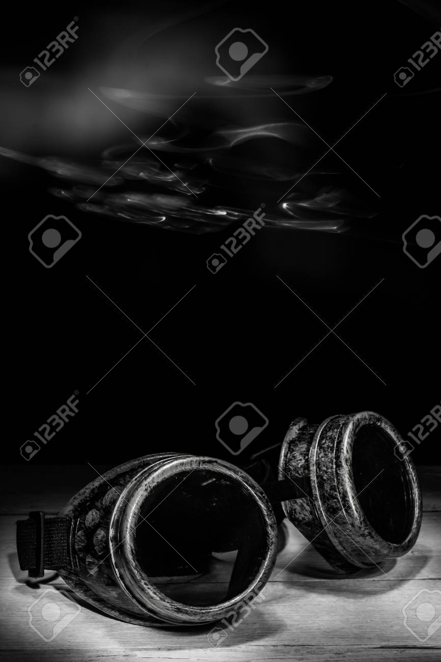 3800683fed6 Steampunk glasses metal collage. light brush Stock Photo - 51875729