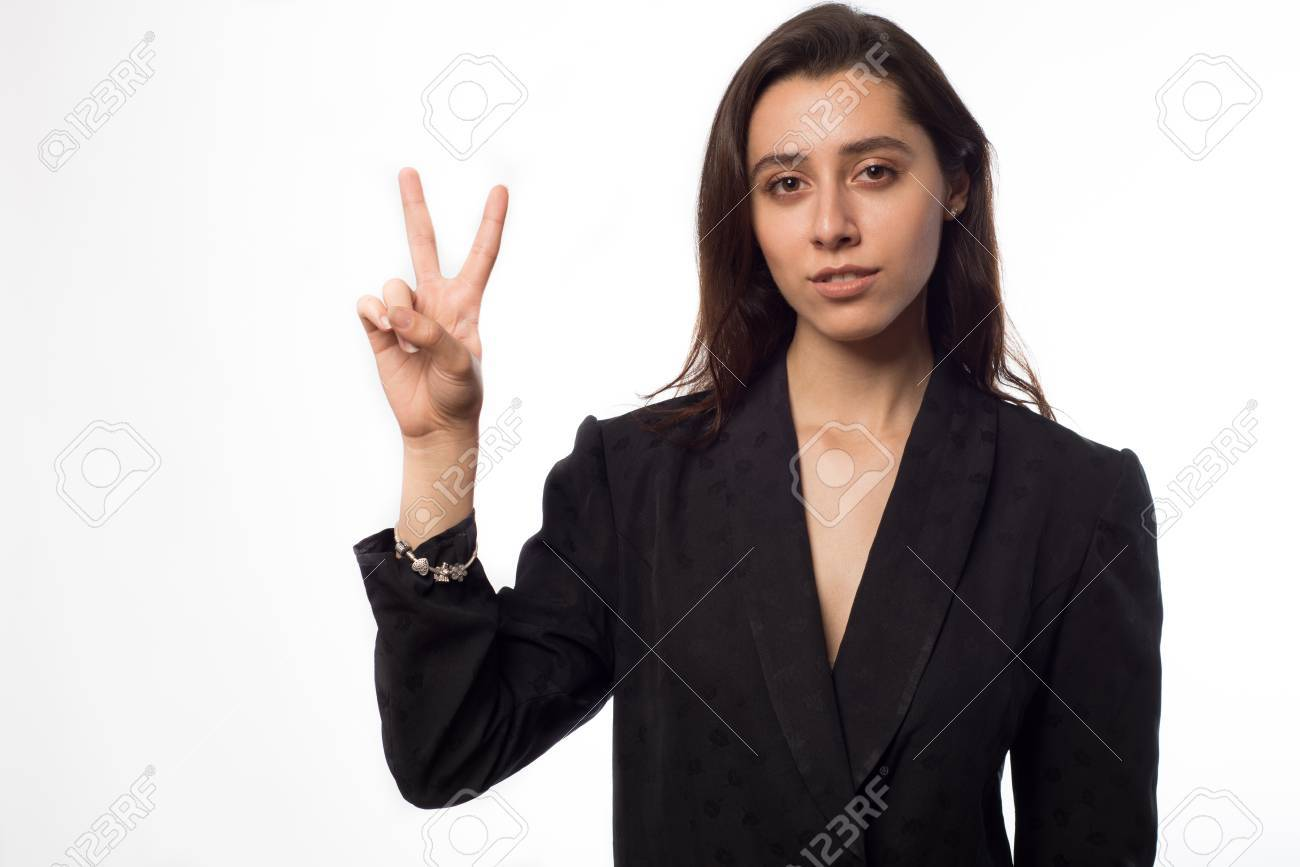A Young Beautiful Indian Girl Raising Two Fingers Up On Hand