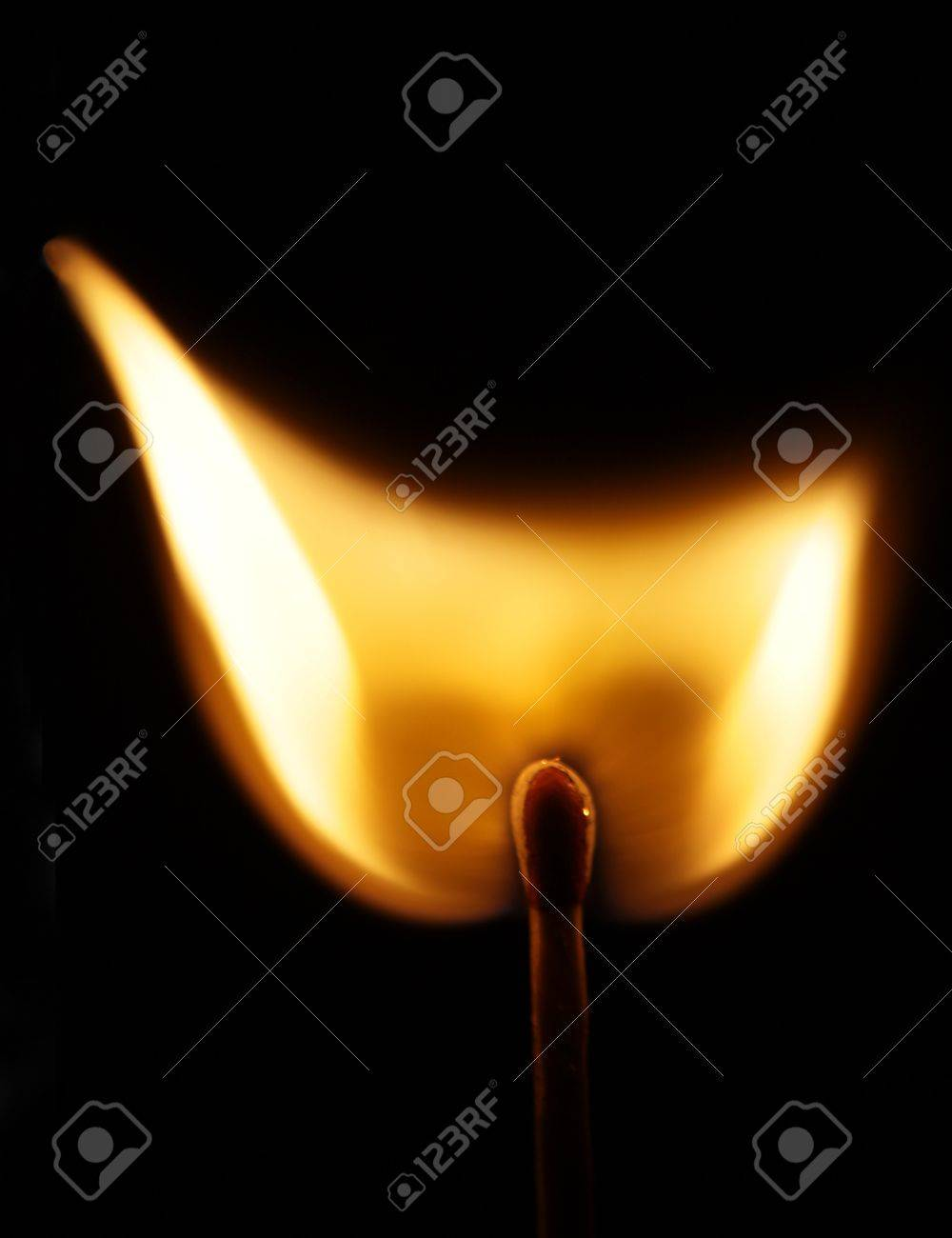 Flame from a lit match isolated on black background. Stock Photo - 16437869