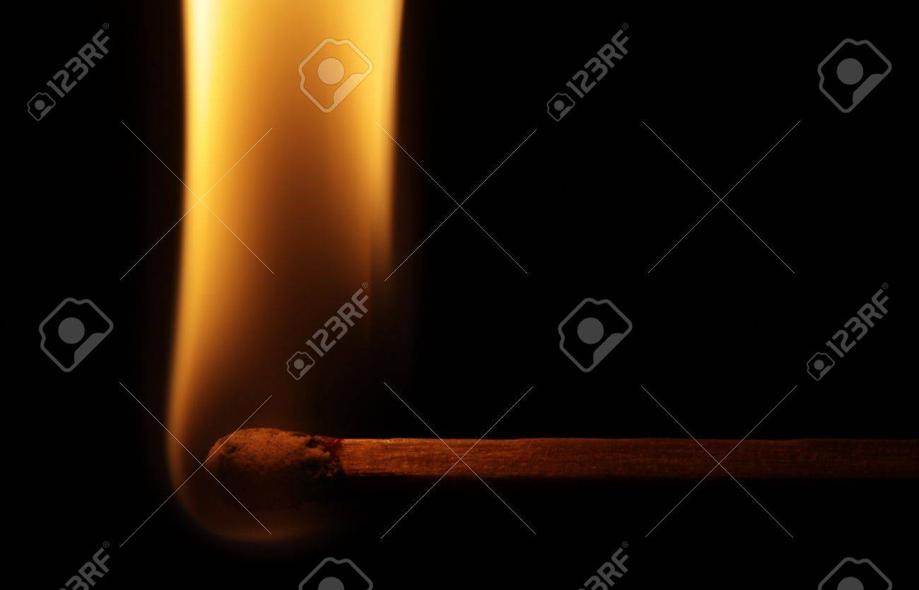 Horizontal lit match with flame isolated on black background Stock Photo - 16437867