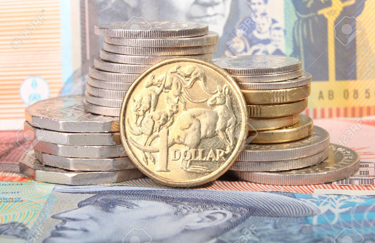 Eine Australische Gold Dollar Münze Sitzt Neben Einem Stapel Von