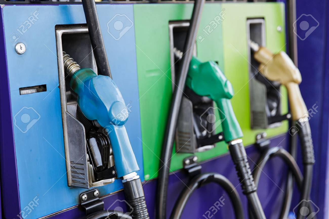Gas pump nozzles in a service station - 51192383