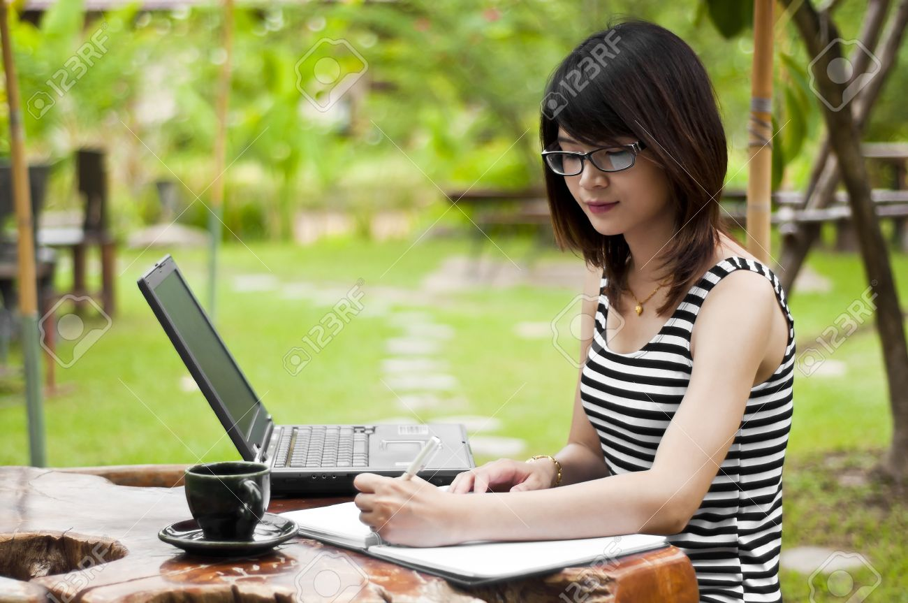 Beautiful asian woman writing stock photo picture and royalty free beautiful asian woman writing stock photo 20539880 publicscrutiny Gallery