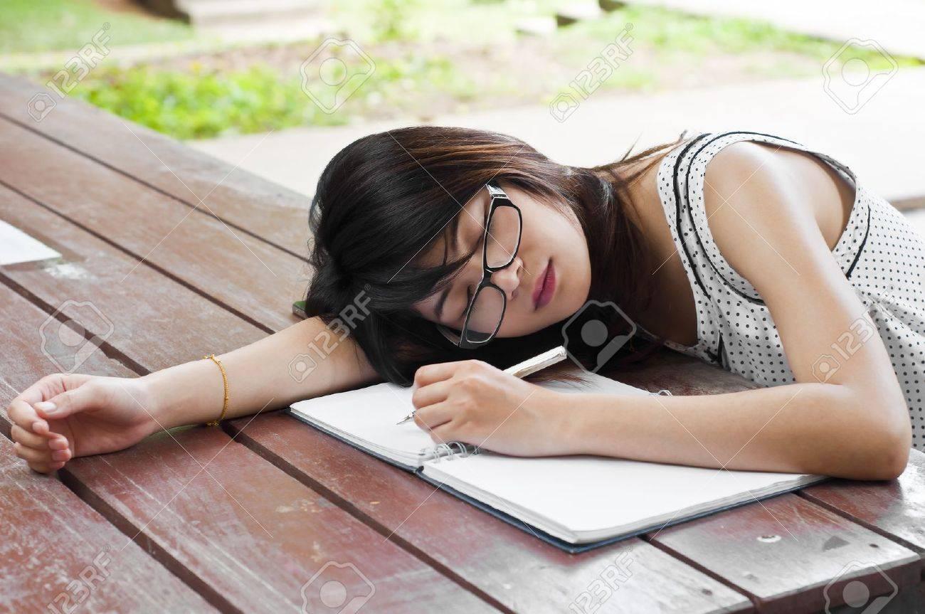 Beautiful Asian student woman tired and sleep Stock Photo - 21356824
