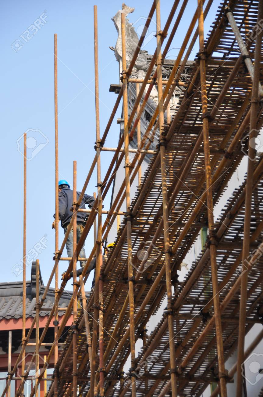 Chinese Labour In Construction Site Man On Bamboo Scaffold Stock Photo Picture And Royalty Free Image Image 94156048