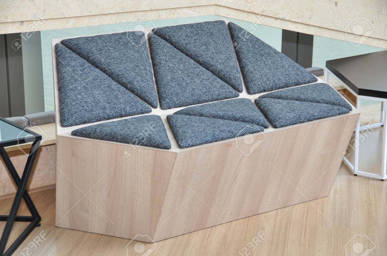 Modern wooden sofa with black triangle shape textile pad.
