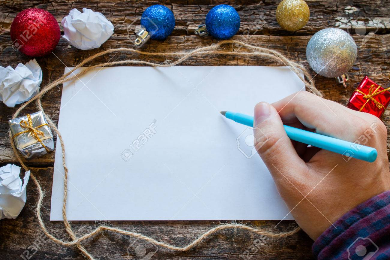 man writes a list of gifts for the new year - 44176871