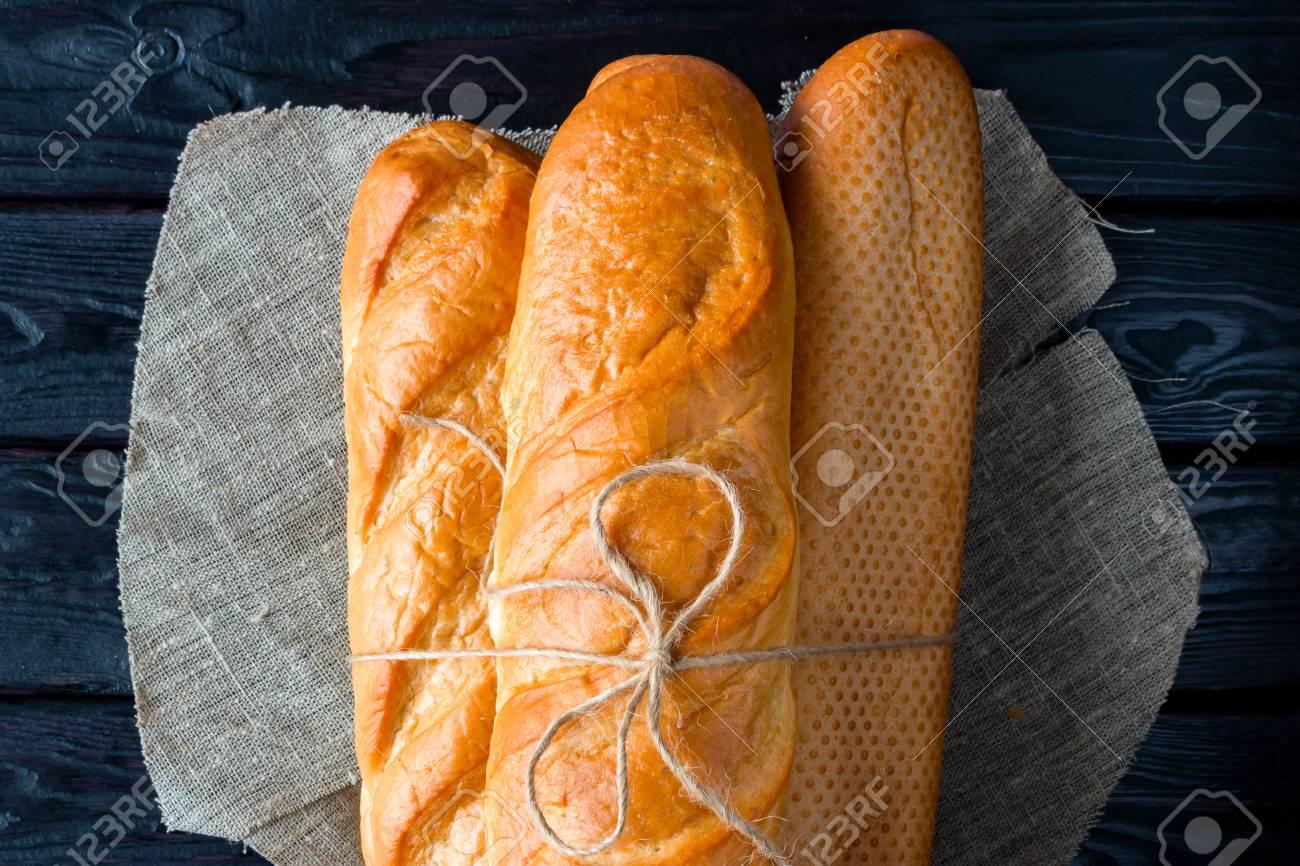 few loaves of bread on a napkin - 50870136