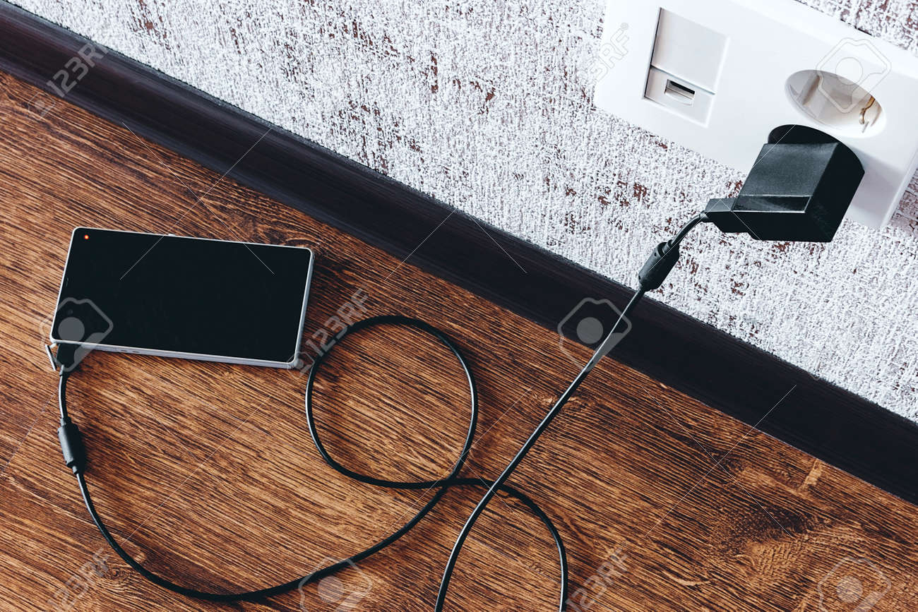 phone charging in the apartment on the floor - 166172180