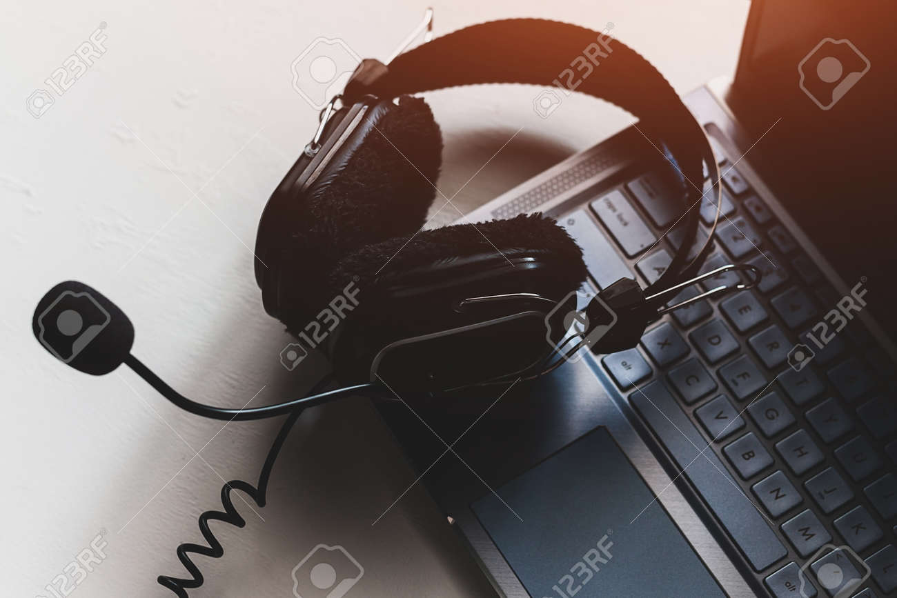 headphones on laptop keyboard concept remote work, distance education - 166172250