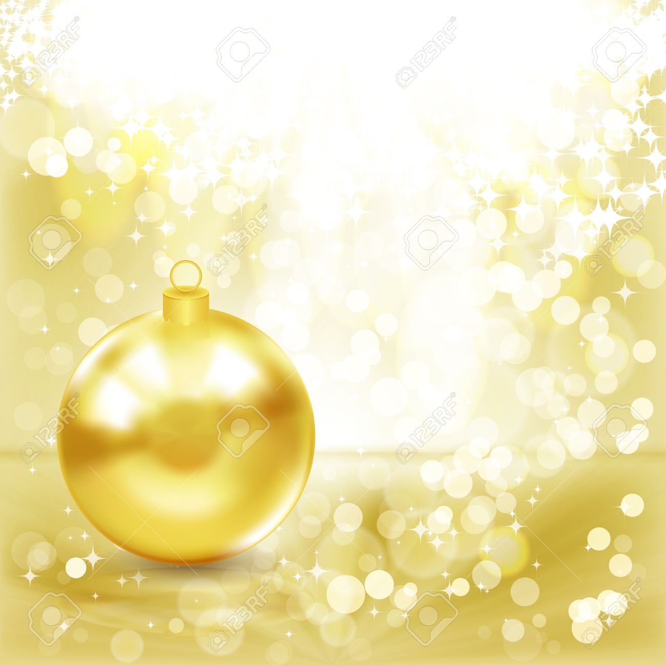 Gold Christmas ball on a golden light background. Stock Photo - 11261793