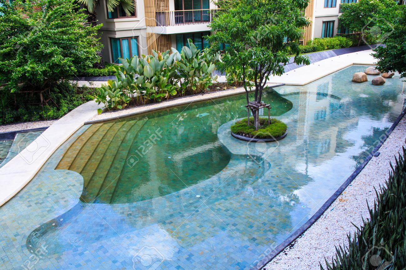 Residential Inground Swimming Pool In Backyard Stock Photo