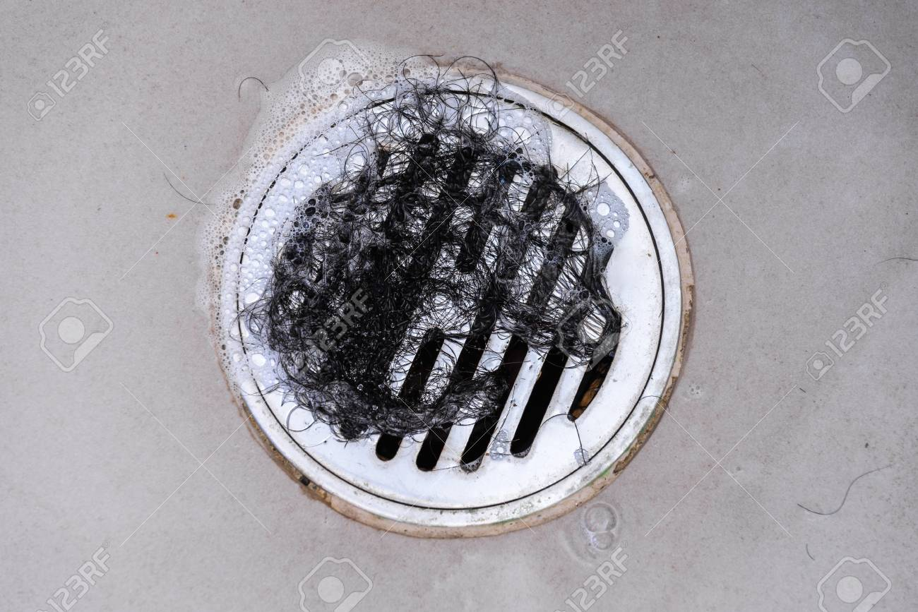 Hair Clump In Bath Drain While Taking A Shower. Stock Photo, Picture ...