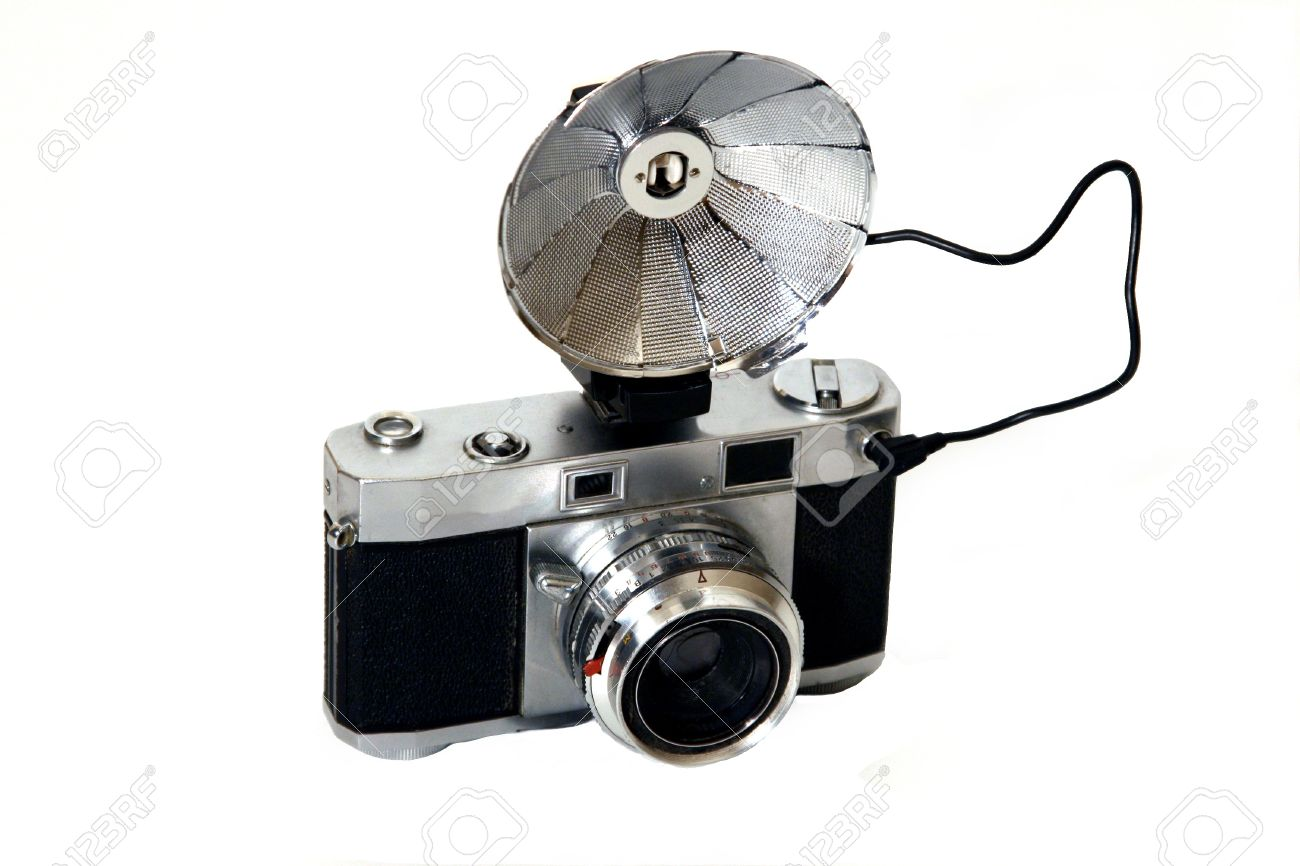Old camera and flash on a white background. Stock Photo - 16578118