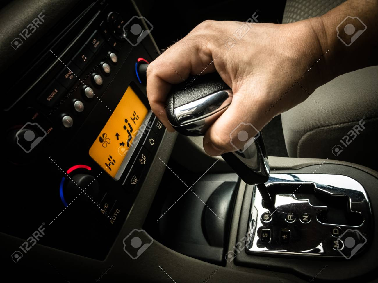 hand on a gear shift, drive stick in a car