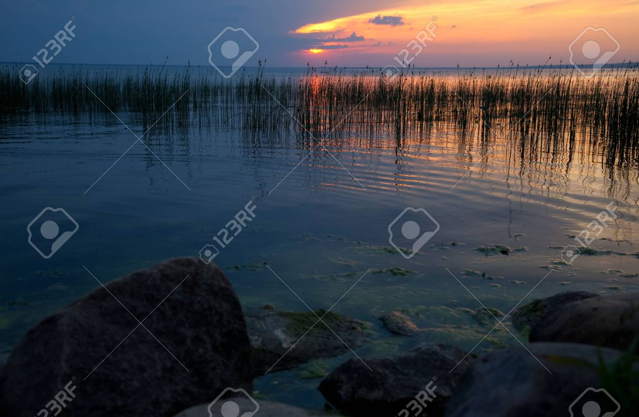 Evening on Lake Pleshcheevo with rock in foreground Stock Photo - 6088136