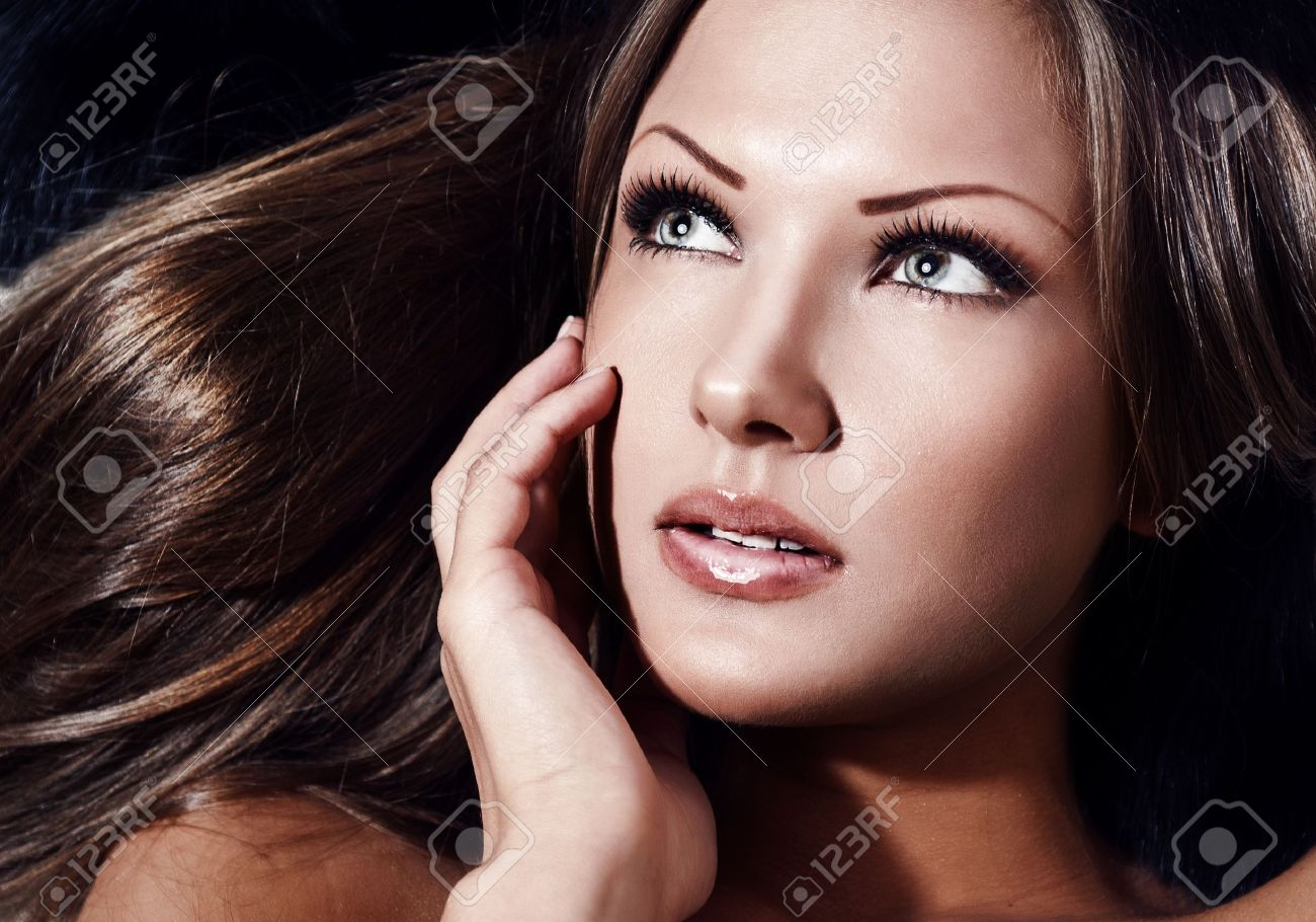 closeup portrait of a young beautiful sensual woman with perfect clean skin face , make up Stock Photo - 15587925
