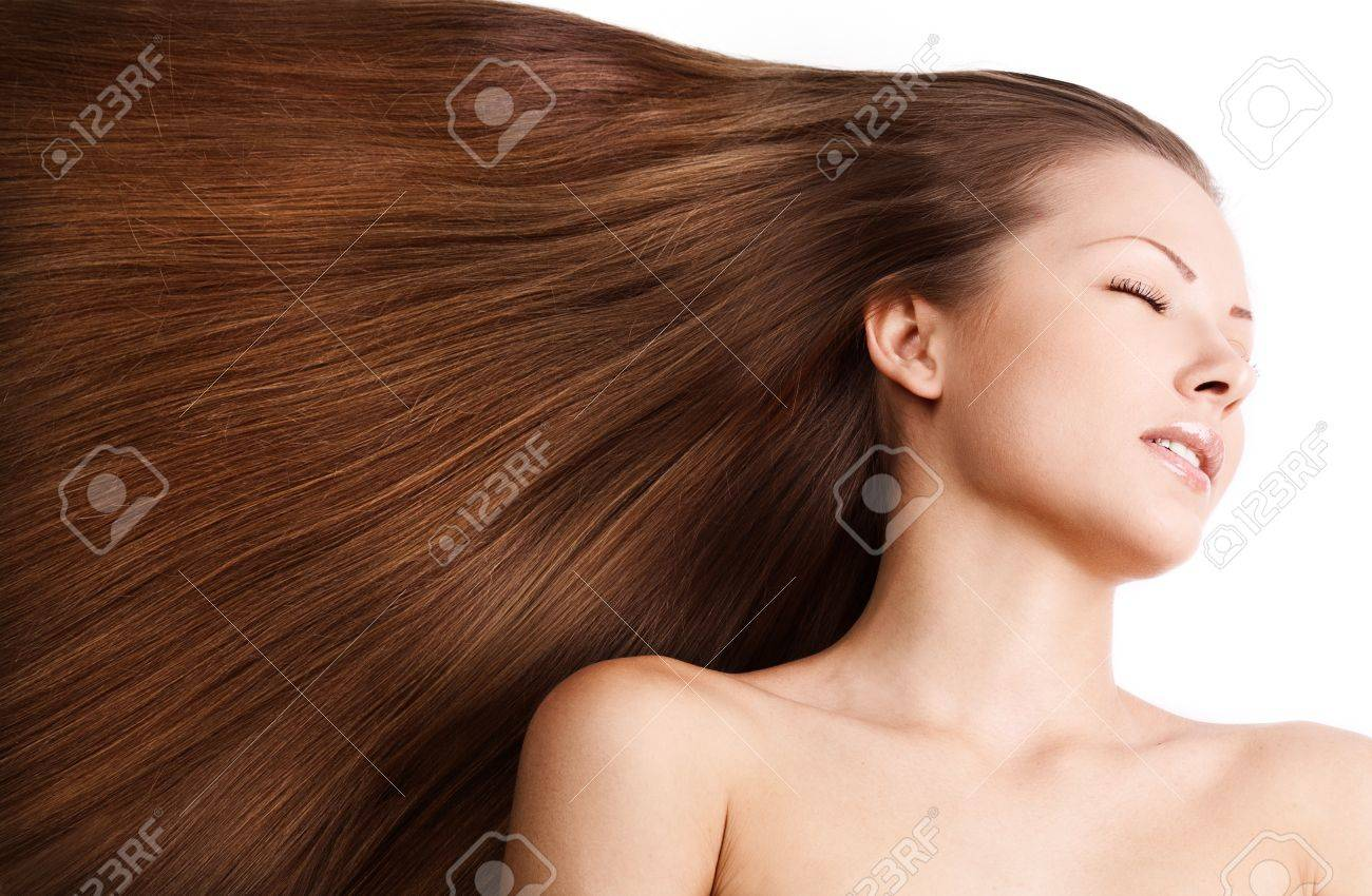 young beautiful girl with beautiful long brown healthy shiny hair Stock Photo - 15587935