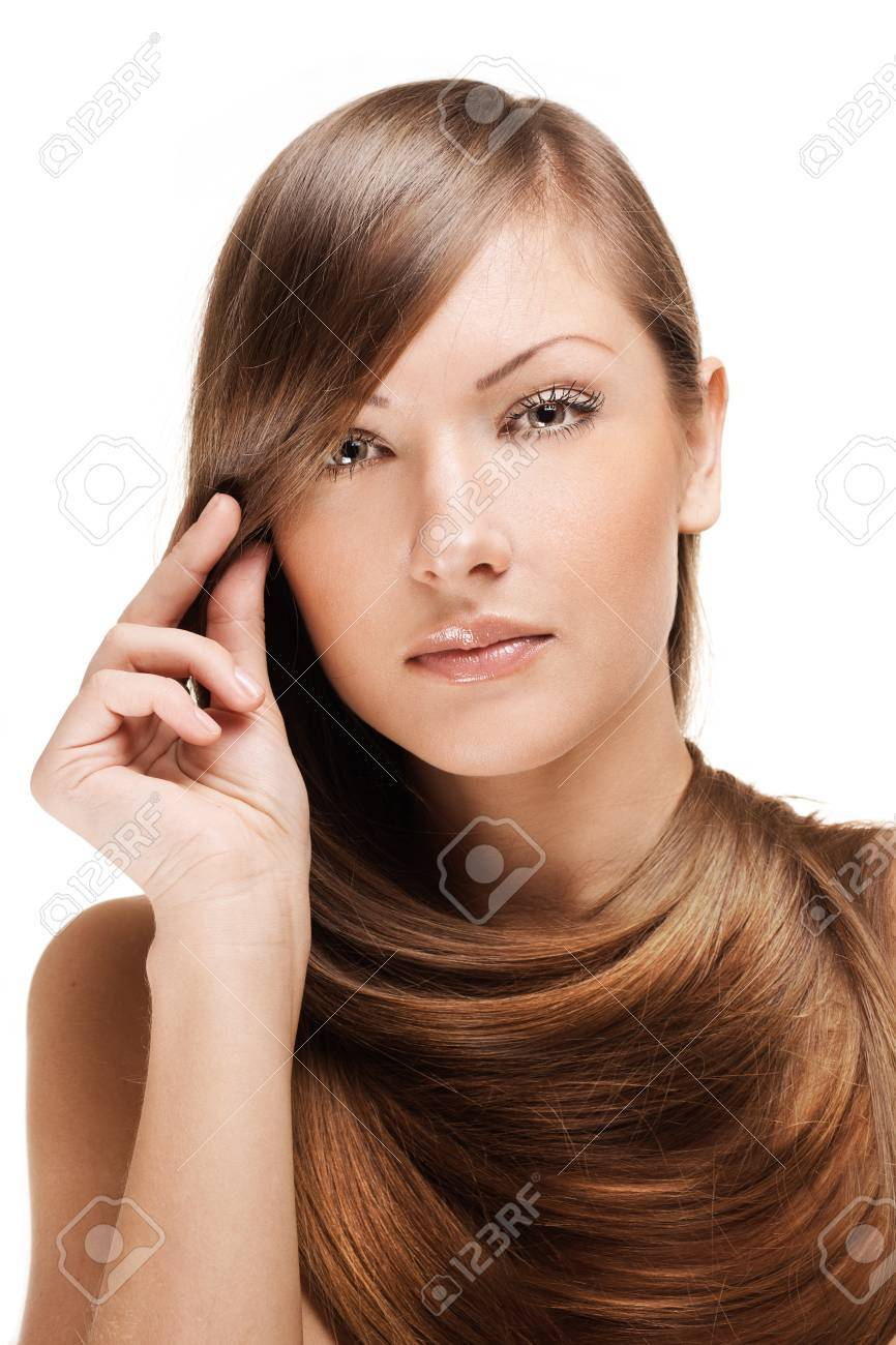 closeup portrait of a beautiful young woman with elegant long shiny hair , hairstyle , isolated on white background Stock Photo - 15661600
